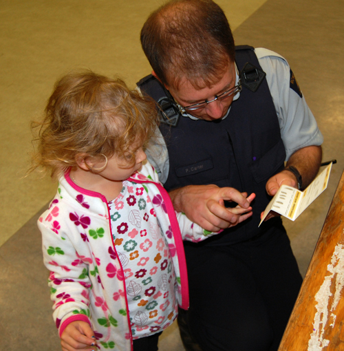 But Kidz Printz, while there were elements of fun, Kidz Printz ultimately had a serious purpose, helping keep kids safe. Here, Auxiliary Constable Paul Carter takes Ava Lund's fingerprints. David F. Rooney photo
