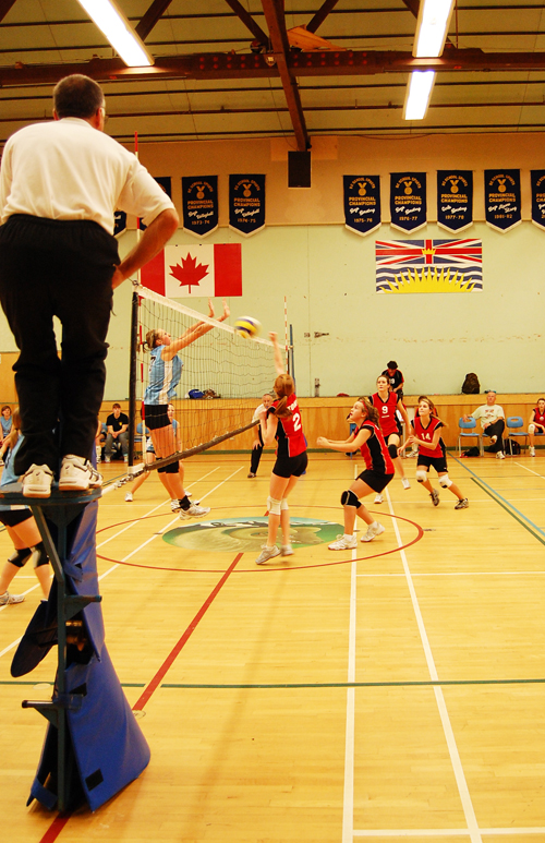 Revelstoke's Ellie Bay (center) reaches to block the ball as a player from Quesnel's Correlieu Secondary School slaps it over the net during the Last Spike Junior Girls Championship on Saturday. Revelstoke won silver int he tournament. David F. Rooney photo