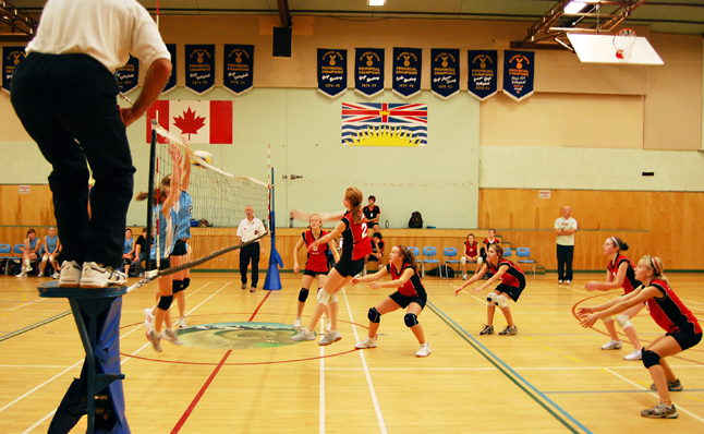 Ellie Bay (center) leaps and slaps the volleyball over the net during the Last Spike Girls' Championship game on Saturday. David F. Rooney photo