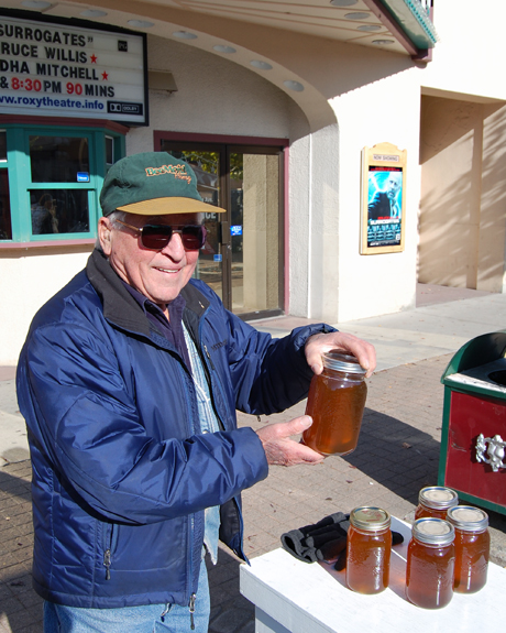 Joe Mueller had the sweet stuff ready to go — fresh local honey. David F. Rooney photo
