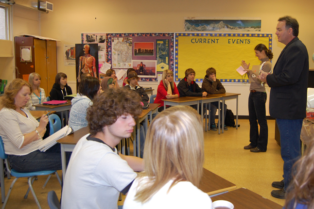 Columbia River-Revelstoke MLA Norm Macdonald (center, right) gets ready to talk with students in Kendra Von Bremen's (center, left) Social Studies 11 class Friday about the BC Legislature and the provincial political scene. Macdonald, a former teacher and school principal, enjoys meeting with teens and talking about the ways they can be engaged with the political life of the province. David F. Rooney