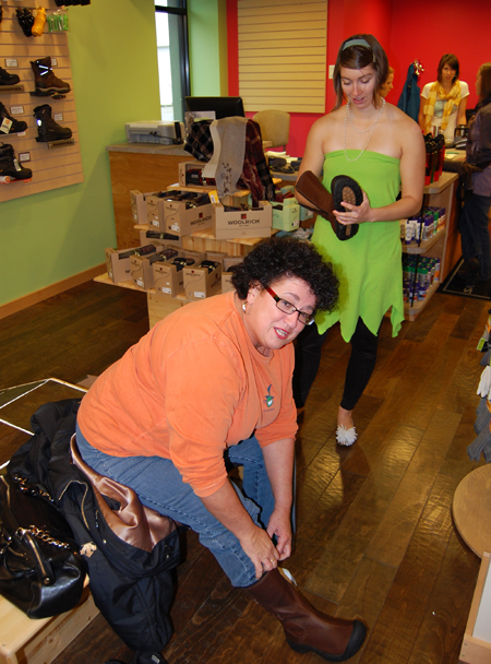 Tinkerbell Dale Gowdry helps Laurel Russell find the perfect set of boots at Wearabouts. David F. Rooney photo