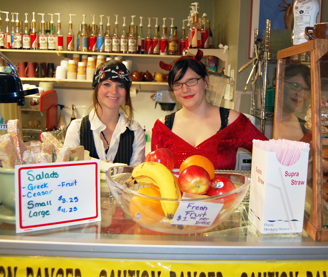 Sidney Gould and Ashley Peterson were the well-costumed staff behind the counter at Conversations on Halloween afternoon. David F. Rooney photo