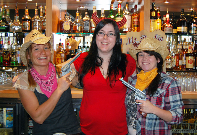 A block over at the Grizzly Pub cowgirls Julie Gamache and Meghan Jenny held up that every-so-tempting devil, Delaney Bos. David F. Rooney photo