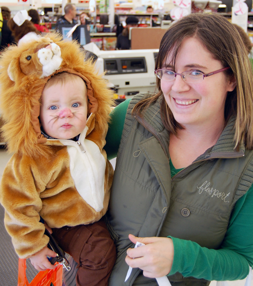 Cooper's Foods always has a tradition of dressing up and this year so did the odd customer, like this young mom and her 13-month-old lion. David F. Rooney photo