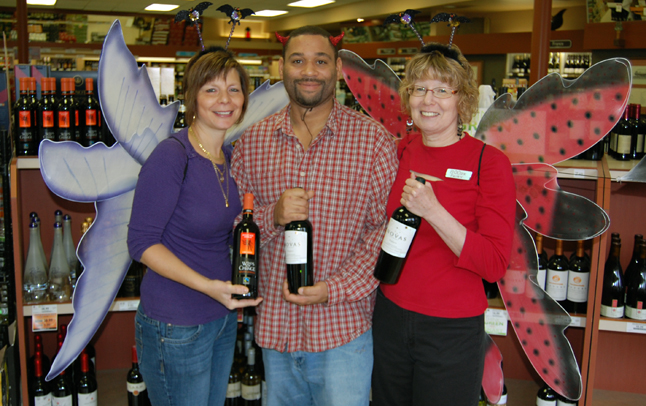 Meanwhile, over at the BC Liquor Store, Beryl Buckley (right) enjouyed her last day of work after 31 years of service with a pair of wings and the company fellow Booze Fairy Angela Thompson and that sly devil Jeffrey Howe. David F. Rooney photo