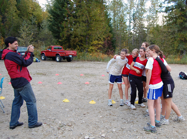 RSS teacher Rory Luxmoore takes a group photo of the RSS girls who limbered up for a cross-country run against several other regional schools at the Mount Macpherson ski area Wednesday. David F. Rooney photo