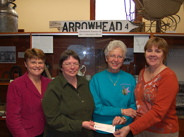 Here's a fine example of South Country generosity. Kathie Mackey (left) and Judy Vigue and Dale Marcolli (center and right) posed with Revelstoke Museum Curator English (center) as they presented her with a cheque for $350 that was raised by the folks who attended the South Country Reunion during last summer's 2009 Homecoming Celebration. English was very grateful and said the money will help her pay for more microfilms to preserve the museum's old newspapers. David F. Rooney photo