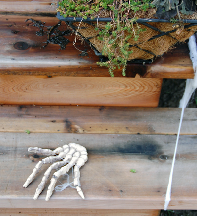 ... a skeletal hand on one of the steps leading to the front door. Will it leap out an grab an unwary trick-or-treater? We'll find out on Halloween. David F. Rooney photo