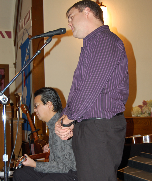 Steve Smith didn;t just MC the event; he was also a performer. He sang solo and with Steven Hui (left) on guitar. David F. Rooney photo