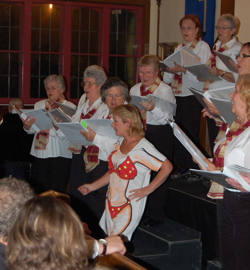 ... provoked real laughter as Jan Highes sashayed out from behind wearing a bikini T-shirt for the choir's performance of Little Yellow Polka Dot Bikini. David F. Rooney photo