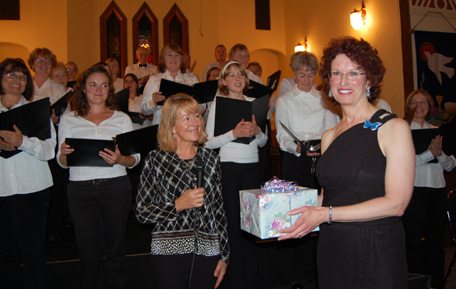 As performers looked on, Brenda Kessler (center, left), the Revelstoke Hospice Society's executive director, presented Robyn Abear with a small token of the society's appreciation for her work in making the concert not just a reality but a top-quality event. David F. Rooney photo