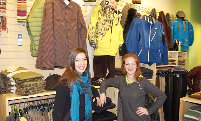 Wearbouts manager Monica Hardy (right) poses with sales staffer Cara Funke in front of some of the clothing on offer at the small, local chain's new store at the corner of Second Street and Mackenzie Avenue. David F. Rooney photo