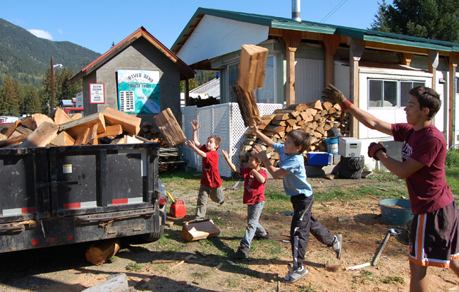 Picking fruit was light duty compared to piling a trailer full of firewood as (from left to right) Jacob Babak and Max, Rocky and Dylan Kampman did during the early part of Sunday afternoon. David F. Rooney photo