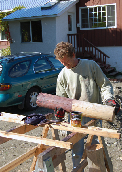 "The warm sunshine was great, too, if you were working with some kind of odoriferous material, like the acrylic-latex stain David Hawthorne applied to the log butts he was using to edge his driveway. ""I though it would be easy but it's getting to be a big job,"" he laughed. ""It's a labour of love, I guess."" David F. Rooney photo"