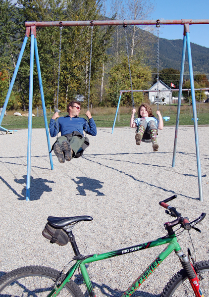 Warm sunshine was also great for playing in, as Daniel Saunders discovered when he and his daughter, Sierra Frazier, stopped for a swing while biking through Kovachs Park. David F. Rooney photo