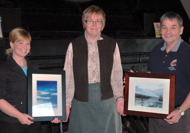 CBT Liaison Lynda LaFleur (center) poses with Grand Prize winner George Hopkins (right) and Freya Rasmussen (left). Rasmussen's photo of skiing near Mount McCrea was one judged one of the top ten photos in the CBT's Show Us Your Basin photography contest. Hopkins' photo of a steam train crossing the Columbia was the best in the show. Congratulations! Photo courtesy of the Columbia Basin Trust