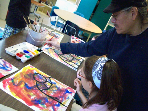 Jerry Whitehead helps Chloe Speerbrecker with her painting at Columbia Park Elementary School. Photo courtesy of Jannica Hoskins
