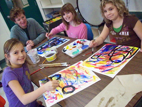 Brynn Smith, Anna Pfeiffer, Emily Hills and Mrs. Madlung working on their art at CPE. Photo courtesy of Jannica Hoskins