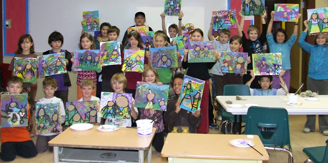 Students in Mrs. Heshaw's and Mrs. Floyd's classes show off the art work they created with the help of native artist Jerry Whitehead this week. Photo by student photographer Sarah Boaz
