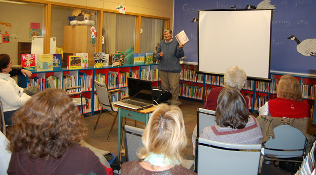 BC author Chris Czajkowski speaks before an audience of 32 people who attended her slideshow based on her book A Mountain Year at the Revelstoke Public Library on Wednesday. Czajkowski moved into BC's Central Coast Mountains in 1988 to build a homestead, a business, and a life. A Mountain Year is her illustrated journal describing the splendour of seasonal transformation in the high-altitude wilderness near Tweedsmuir Park. David F. Rooney photo