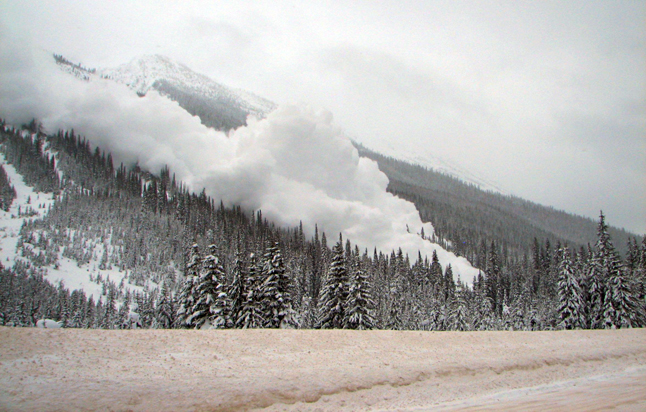 An avalanche thunders down a mountainside in Glacier National Park. Photo courtesy of Parks Canada