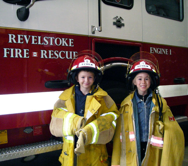 Saelin Cadieux of Mountain View Elementary school and Sammy LeRose of Mount Begbie Elementary School were this year's Fire Chief for a Day Winners. Saelin and Sammy's Home Escapee Plans, illustrating their knowledge and understanding of measures to be taken in the event of a home evacuation, were chosen from among 65 submissions. Saelin and Sammy were picked up at school on Wednesday in Revelstoke Fire Services Engine No. 1 and spent the afternoon as the City's Fire Chiefs. Chiefs Cadieux and LeRose received a tour of the fire hall, enjoyed fire truck rides, received prize packages and participated in fire department activities. The two young Fire Chiefs were then treated to a pizza lunch with the Fire Chief and Career Firefighters. Photo courtesy of Revelstoke Fire Services