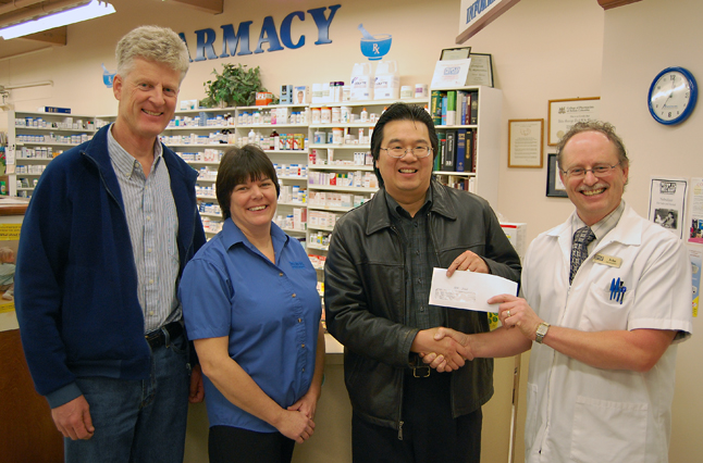 People's Drug Mart has generously donated $2,000 to the Revelstoke Community Foundation so it can continue its work helping local groups and agencies. Here, People's John Teed (right) hands Foundation Chairman Steven Hui a cheque to the two grand as Kevin Lavelle (left), the Foundation;s past chairman, and People's employee Leah Parker look on. People's Drug Mart has an annual golf tournament in Kelowna every year as a fund-raiser. The Revelstoke store was this year's recipient and Teed decided to put the money to work through the Foundation. David F. Rooney photo