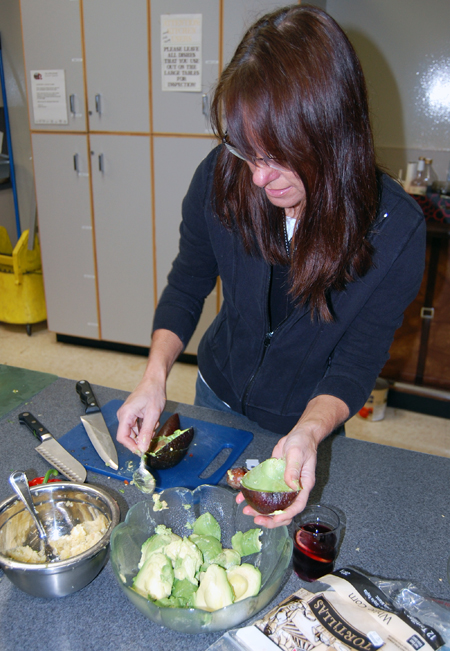 Andrea Pont scoops fresh avocado from its rind prior to whipping up some guacamole. David F. Rooney photo