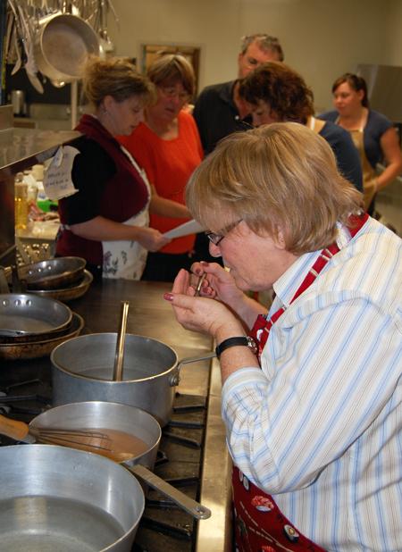 Instructor Ginger Shoji taste the miso soup. David F. Rooney photo