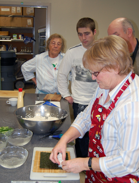 Instructor Ginger Shoji shows her students the proper way to layout the filling for a sushi roll. David F. Rooney photo