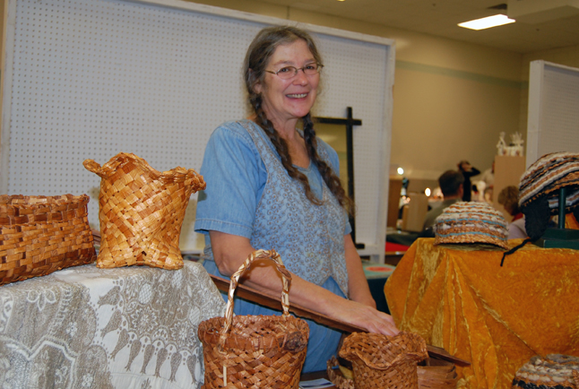 Eloise Charet proudly smiles as she talks about her hand-woven cedar bark hats, baskets and other items. David F. Rooney photo