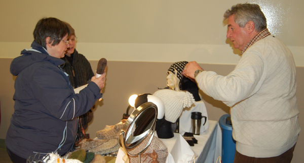 Cathy English liked the products on offer from Gary and Maria Frey's Alpenrose Alpacas booth. David F. Rooney photo