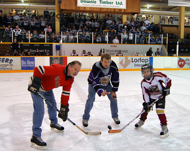 John Macko, a defenceman for the Revelstoke Selkirks back in the 1970s, faces off against Matt Cadden, a member of the Revelstoke Minor Hockey Association's Novice team as John Leeder drops the puck for a ceremonial face-off symbolizing the passing of hockey tradition from one generation to another. The event was held at the Forum on Sunday afternoon as part of the campaign to win Hockeyville status for Revelstoke. David F. Rooney photo
