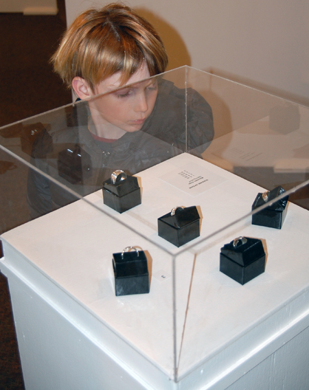 This youngster was mesmerized by Suzanne Spisani's display of silver rings.  David F. Rooney photo