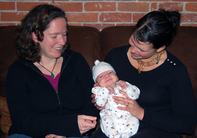 Young Clifford Edwards gurgles happily in the arms of his mother, Jennifer Nothstein, as Midwife Birte Paschen smiles beside them. Young Master Edwards was delivered under Pachen's supervision six weeks ago. Paschen is the only midwife in Revelstoke. David F. Rooney photo
