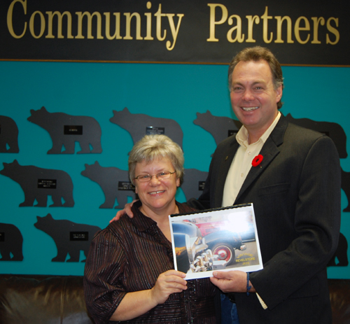 MLA Norm Macdonald (right) poses with Food Bank Coordinator Patti Larson after purchasing a copy of the calendar filled with great photos of old cars that was deigned by Brent Lea. The calendar is being sold for about $20 each at Pharmasave, Community Connections and other locations. The proceeds go to support the Food Bank. David F. Rooney photo
