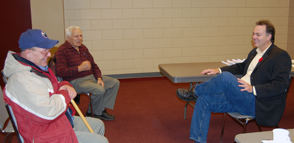 Seniors Floyd Falcon (left) and Louis Rota (center) chat with MLA Norm Macdonald at a Seniors' Tea he held at the Community Centre on Tuesday to discuss seniors' issues. David F. Rooney photo