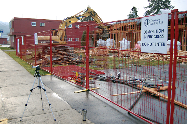 A Revelstoke Current video camera records the beginning of the two-day demolition of the old, asbestos-contaminated wing of Moberley Manor on Tuesday morning. The wing, which was the original structure of the community institution, will be completely flatted on Wednesday. David F. Rooney photo