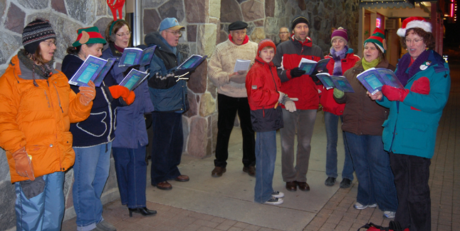 Members of the Community Choir lifted the spirits of Moonlight Madness shoppers with their street-corner carolling. David F. Rooney photo