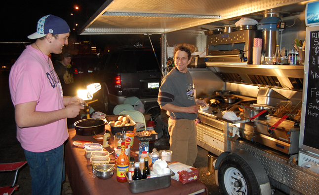 Dale Caverly of Scratch whipped up burgers, dogs and other street treats for hungry shoppers. David F. Rooney photo