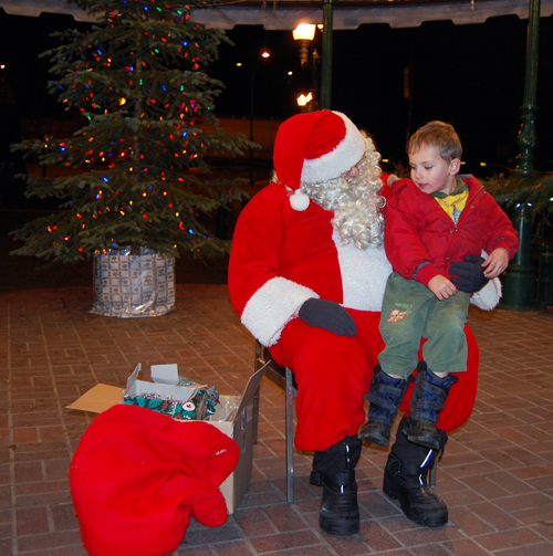 Young Dale Mulligan had his eye on Santa's bag of presents as he told him he had certainly been a very good boy all year. David F. Rooney photo