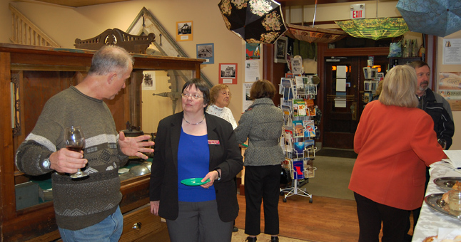 Heritage Committee Chairman Mike Dragani (left) talks with Museum Curator Cathy English at the 50th Anniversary Celebration held at the Revelstoke Museum & Archives on Friday evening. David F. Rooney photo