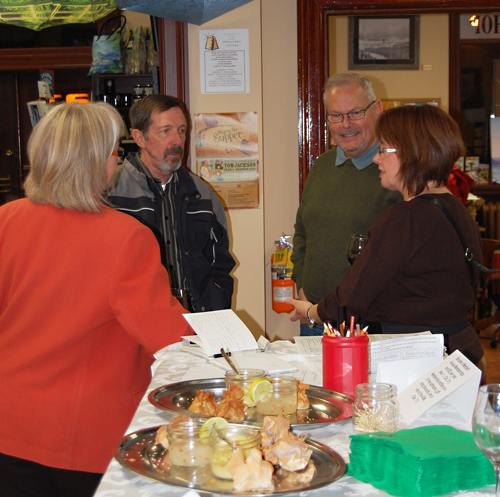 Sharon Kelley (left) and her husband Jim Cook (center) talk with friends at the Museum's 50th Anniversary Celebration. David F. Rooney photo