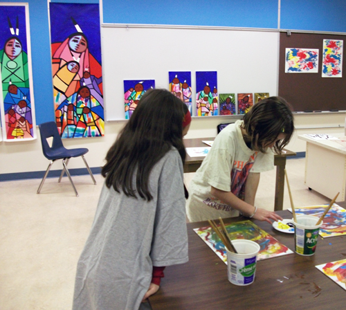 AHE students Zoe Kramer and Claudia Cinelli create First Nations paintings. Photo by student photographer Jacueline Cottingham