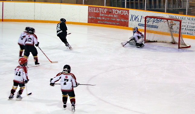 The Junior Grizzlies were under a lot of pressure but the goalie managed to make some pretty good saves. David F. Rooney photo