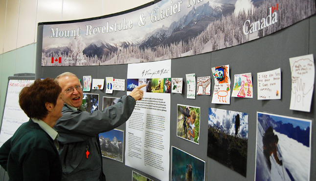 Retied parks Canada biologist John Woods talks with Karen Tierney, superintendent of Mount Revelstoke and Glacier National Parks, at an open house at the Community Centre Tuesday that was held to seek public input on the draft Mountain Parks Management Plan. David F. Rooney photo