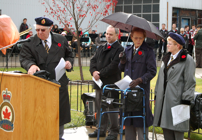 John Opra (left) clears the podium as Mayor David Raven, Legion Chaplain Marlene MacQuarrie and Legion Branch 46 President Sue Driediger wait for the start of the official ceremony. David F. Rooney photo,