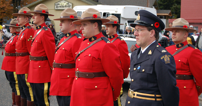 Members of the RCMP detachment present a bold splash of scarlet in their dress uniforms. David F. Rooney photo