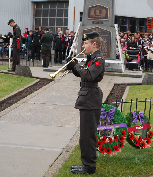 Rocky Mountain Ranger Gregory O'Hagan plays the Last Post to mark the two minutes of silence as the huge crowd honoured Revelstoke's — and Canada's — war dead. David F. Rooney photo